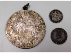 A mounted silver Thaler twinned with an 1872 US di