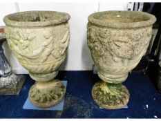 A pair of large two piece pedestal reconstituted s