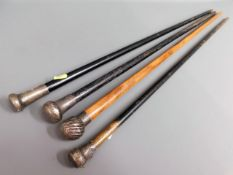 Four silver topped walking canes, few bumps, one b
