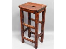 A vintage stained oak bar stool, 30.5in high x 14.