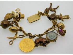 An 18ct gold charm bracelet set with 16 charms, ni