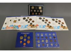 A small collection of six coin sets