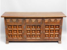 A 20thC. oak sideboard with three cupboards & thre