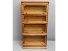 A Cookes of Finsbury Road oak four tier glazed boo