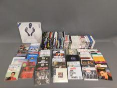 A quantity of music CDs, a Puff Daddy vinyl LP & f