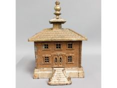 An antique cast iron French money box, 9in tall