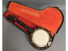 A banjolin with case, 22in long