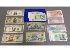 A collection of mixed bank notes including a numbe