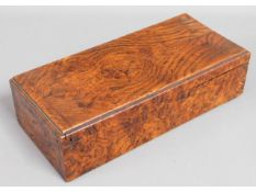 An antique walnut lidded box, 10.5in long x 5in wi