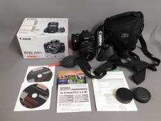 A Canon EOS 350D digital camera with box