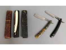 Three boxed cut throat razors, one badly a/f
