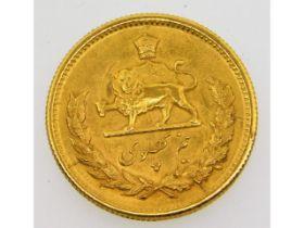 A gold Iranian half Pahlavi coin, 4.2g