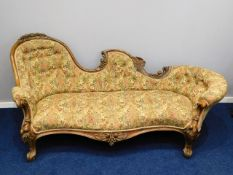 A 19thC. ornate, carved walnut chaise longue, 81in