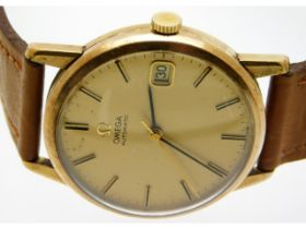 A gents 9ct gold Omega automatic wrist watch with