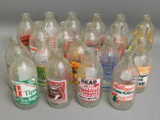 Twenty advertisement milk bottles