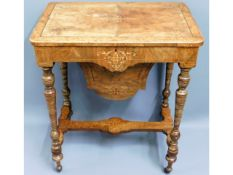 A Regency walnut work table with contents, 27.5in