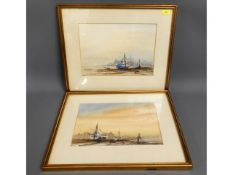 A pair of framed watercolours of yachts moored, in