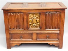 An oak blanket box with linenfold & coat of arms d