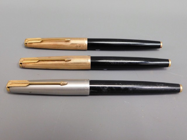 Three vintage Parker fountain pens including a Parker 61
