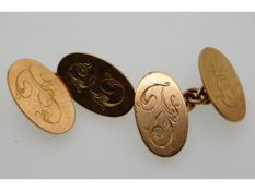 A pair of 9ct rose gold cuff links initialed F E,