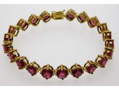 A 9ct gold bracelet set with twenty one Madagascan