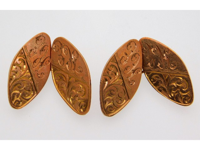 A pair of 9ct gold cuff links, monogrammed, with b