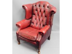 A leather oxblood red leather Chesterfield wing ba