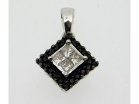 A 10ct white gold pendant set with black & white d