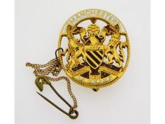 A 9ct gold enamelled 25 year service Fattorini bad