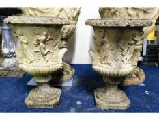 A pair of ornate reconstituted stone campana plant