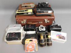 Three 110 film cameras & a quantity of other camer