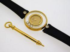 A ladies Chopard 18ct gold Happy Diamonds wrist wa