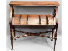 An Edwardian mahogany book trough with shelf over,
