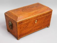 A 19thC. rosewood tea caddy with lion head handles