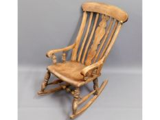 An antique elm seated antique Windsor style rockin
