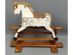 A small child's rocking horse, 32in long x 27.5in