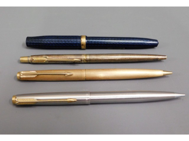 A Conway Stewart fountain pen, two Parker biros &