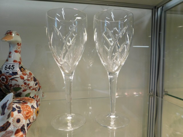 A pair of Waterford crystal wine glasses, one with