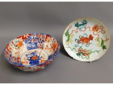 A c.1800 Chinese porcelain plate hand decorated with dogs, 8.25in diameter, (small crack to edge) tw