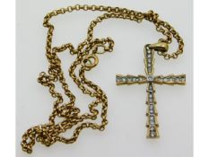 A 9ct gold necklace with cross set with 0.25ct dia