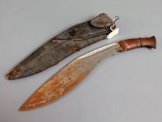 A kukri knife with leather scabbard & wooden handl