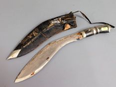 A kukri knife with leather scabbard & horn handle