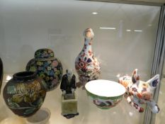 A Chinese porcelain duck & cat, a Chinese ginger j