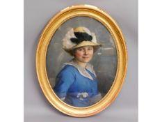 A large decorative oval gilt framed watercolour po