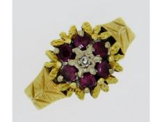An 18ct gold ring set with ruby & small diamond, 5