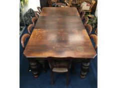 A large English oak extending table with inserts,