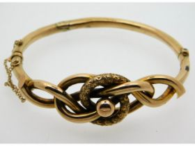 A yellow metal bangle, tests electronically as 9ct