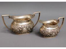 A 1903 Birmingham silver sugar bowl & creamer with