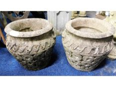 A pair of reconstituted stone planters, 15.25in ta