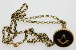 A 9ct gold masonic seal on a 23in 9ct gold chain,